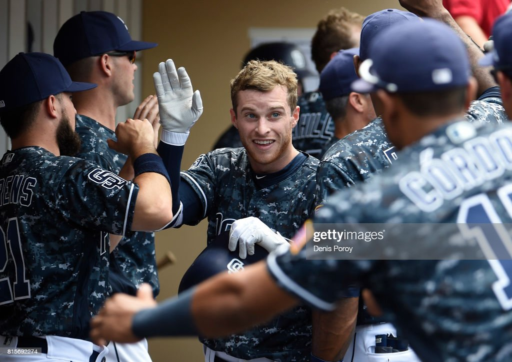 Cory Spangenberg #15 of the San Diego Padres is congratulated after hitting a three-run home run during the third inning of a baseball game against the San Francisco Giants at PETCO Park on July 16, 2017 in San Diego, California.