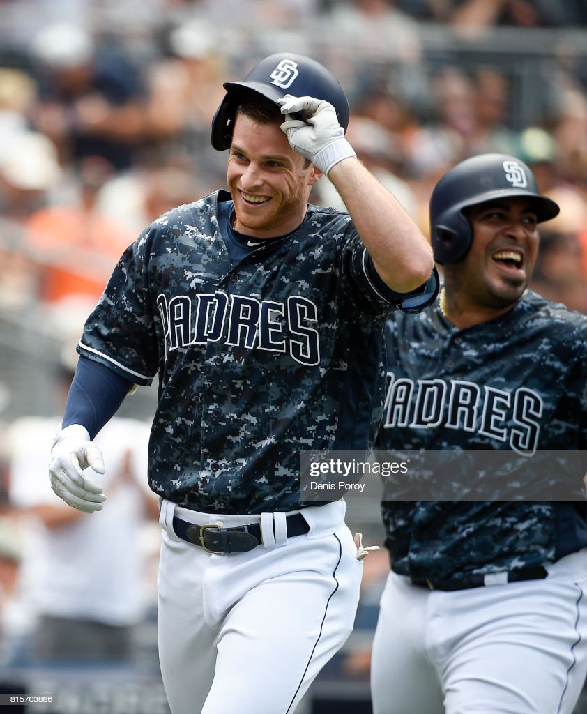 Cory Spangenberg #15 of the San Diego Padres, left, celebrates with Hector Sanchez #44 after hitting a three-run home run during the third inning of a baseball game against the San Francisco Giants at PETCO Park on July 16, 2017 in San Diego, California.