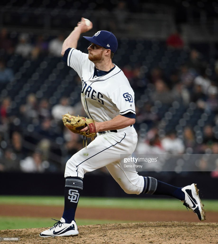 Cory Spangenberg #15 of the San Diego Padres pitches during the ninth inning of a baseball game against the Atlanta Braves at PETCO Park on June 5, 2018 in San Diego, California.