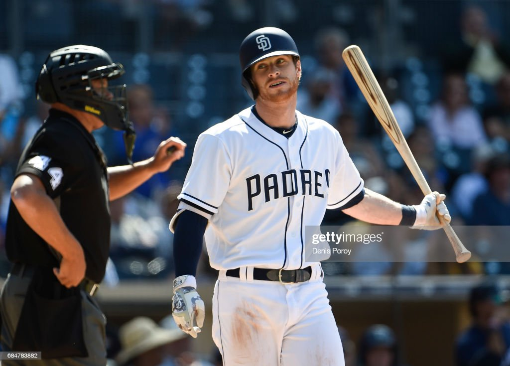 Cory Spangenberg #15 of the San Diego Padres reacts after striking out during the ninth inning of a baseball game against the Milwaukee Brewers at PETCO Park on May 18, 2017 in San Diego, California.