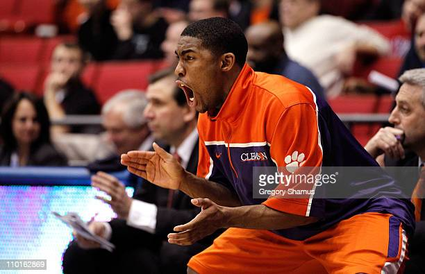 Cory Stanton of the Clemson Tigers cheers from the bench during the game against the UAB Blazers during the first round of the 2011 NCAA men's...