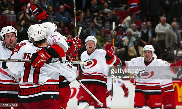 Cory Stillman of the Carolina Hurricanes celebrates with his teammates after scoring the winning goal against the Montreal Canadiens in game six of...