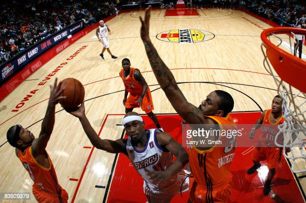 Cory Underwood and Majic Dorsey of the Albuquerque Thunderbirds tries to block a shot against Curtis Stinson of the Iowa Energy on December 04 2008...