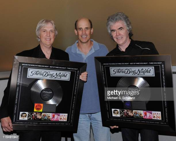Cory Wells of Three Dog Night, Bruce Resnikoff, UME President/CEO, and Danny Hutton of Three Dog Night with plaques presented by Resnikoff to...