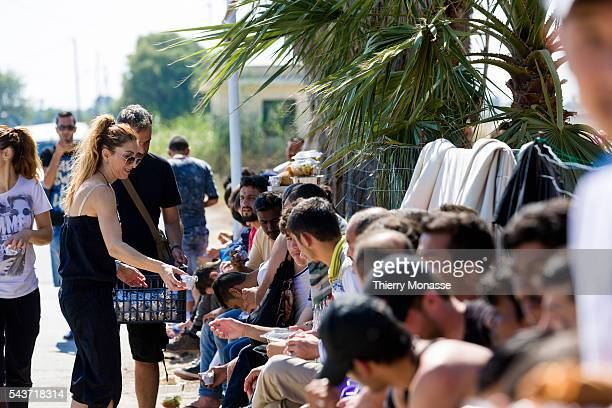 Cos Dodecanese Greece June 13 2015 Illegal migrants mainly from Afghanistan are waiting for food in an abondoned hotel the Hotel Captain Elias Kos...