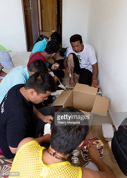 Cos Dodecanese Greece June 13 2015 Illegal migrants mainly from Afghanistan are eating in an abondoned hotel the Hotel Captain Elias Kos island is 4...