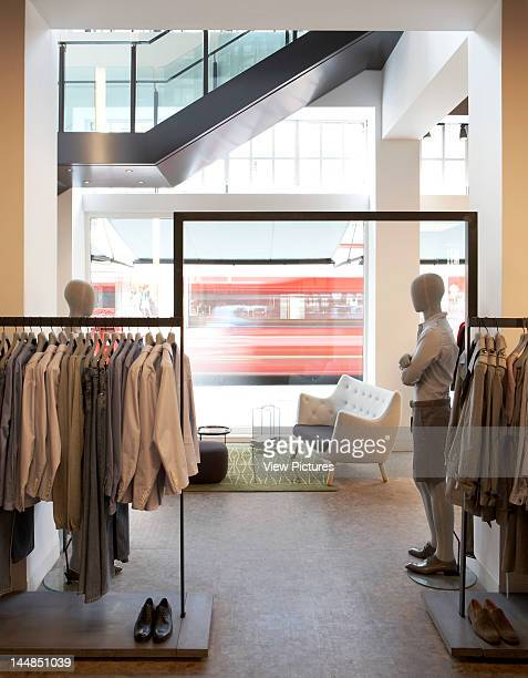 Cos Regents Street London W1 United Kingdom Architect Pentagram Cos Pentagram Store London View Of Hanging Rail With Mannequins In Front Of Window...