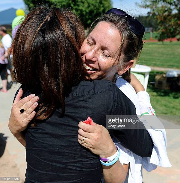 DENVER COSandie Steffes right gets a hug from friend Deryl Isidore at the 3rd annual McKaila Ball a kickball party at the Colorado Rockies Fastpitch...