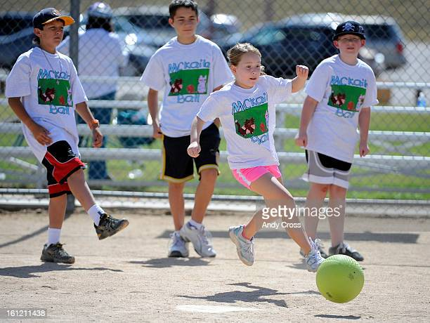 DENVER COSarah Sykora 9yearsold kicks the ball into play during the 3rd annual McKaila Ball a kickball party at the Colorado Rockies Fast pitch...