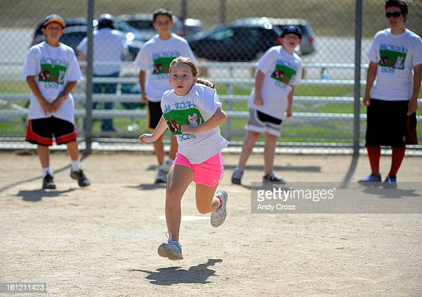 DENVER COSarah Sykora 9yearsold runs to first base after kinking the ball into play during the 3rd annual McKaila Ball a kickball party at the...