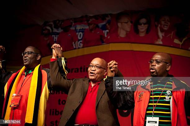 Cosatu General Secretary Zwelinzima Vavi President Jacob Zuma and Cosatu President Sdumo Dlamini hold hands during the unions 11th National Congress...