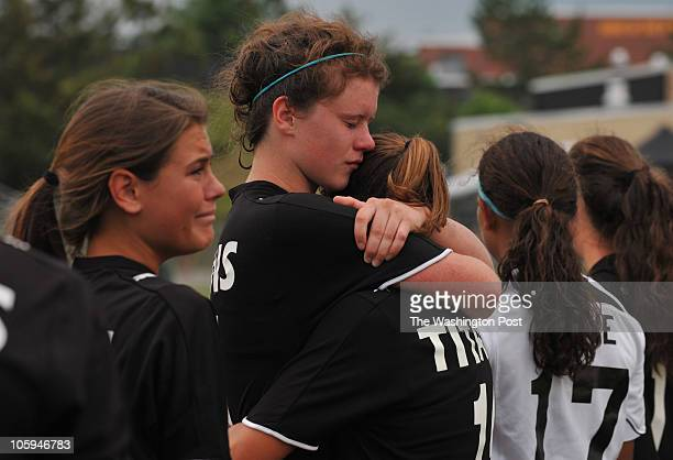 Cosby's Becca Wan center gives a hug to teammate Kelsey Blum as Lexi Davis gets emotional at left after their team lost to Stone Bridge HS in the...