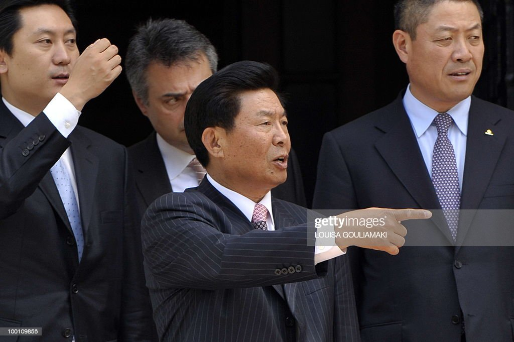 Cosco chairman and CEO Wei Jiafu (C) gestures while leaving Greek prime minister George Papandreou's office after their meeting in Athens on May 21, 2010.Greece has told Chinese shipping giant Cosco that strikes which frequently cripple business in the country will not affect a 35-year port concession vital to its debt-hit economy, Cosco said Friday. AFP PHOTO / Louisa Gouliamaki
