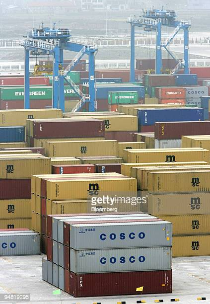 Cosco containers among others wait to be loaded on ships in Ningbo port Zhejiang province China Wednesday March 22 2006 Cosco Pacific Ltd Asia's...