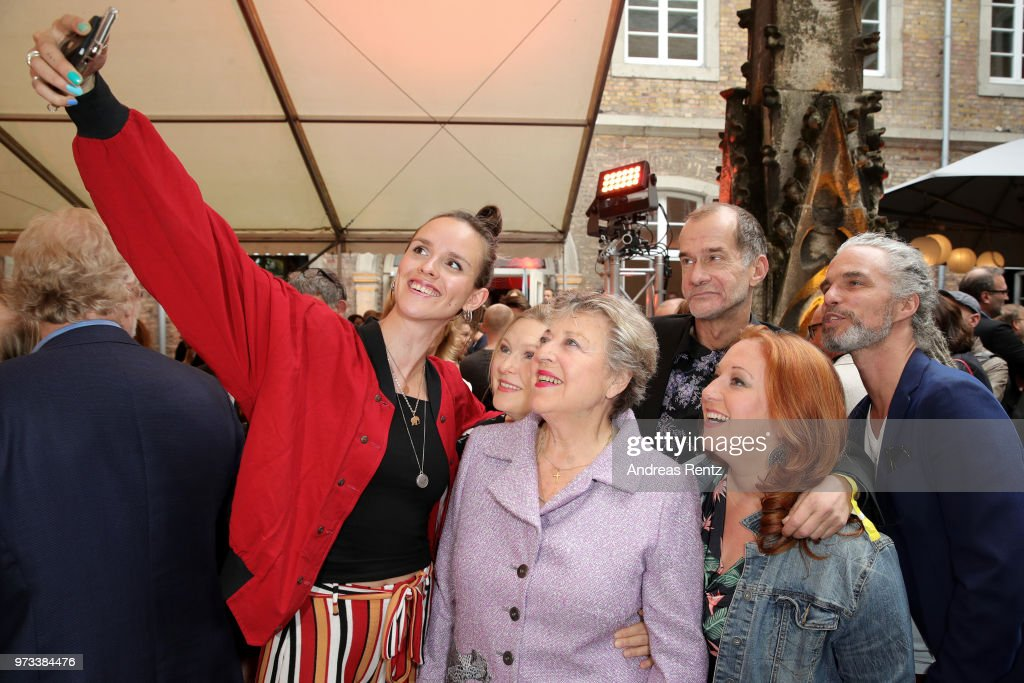 Cosima Viola, Sybille Waury, Marie-Luise Marjan, Georg Uecker, Rebecca Siemoneit-Barum and Moritz Zielke take a selfie as they attend the 'Film- und Medienstiftung NRW' summer party at Wolkenburg on June 13, 2018 in Cologne, Germany.