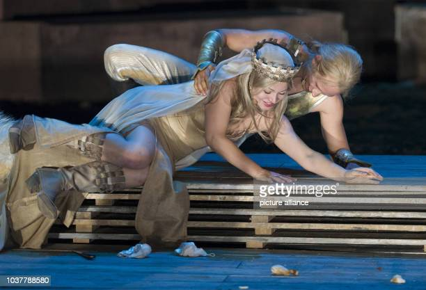 Cosma Shiva Hagen as Kriemhild and Vinzenz Kiefer as Siegfried act on stage during the photo rehearsal of this year's play of the Nibelung Festival...