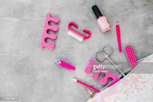 cosmetic bag and manicure set in black background - nail scissors stock pictures, royalty-free photos & images