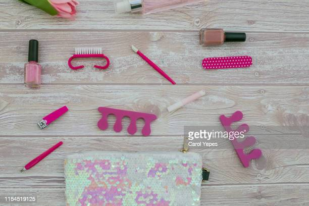 cosmetic bag and manicure set in wooden background - nail scissors stock pictures, royalty-free photos & images