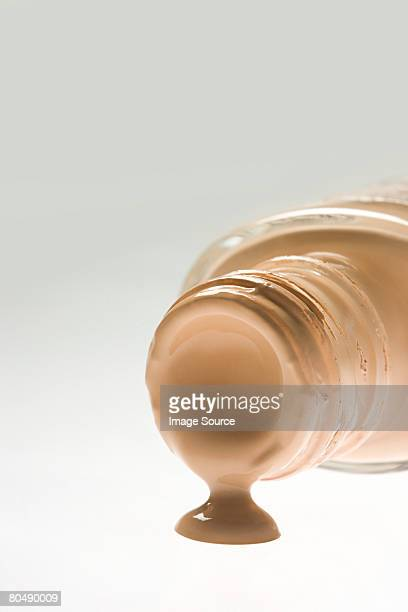 Cosmetic foundation spilling out of a bottle