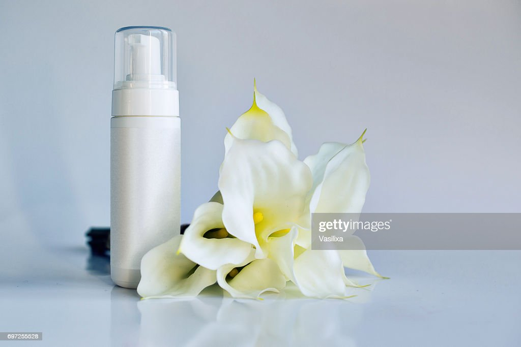 Cosmetic product for cream foam shampoo on white background with cosmetic product for cream foam shampoo on white background with white flowers mightylinksfo