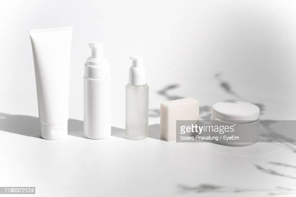 cosmetic products on white background - 化粧品 ストックフォトと画像