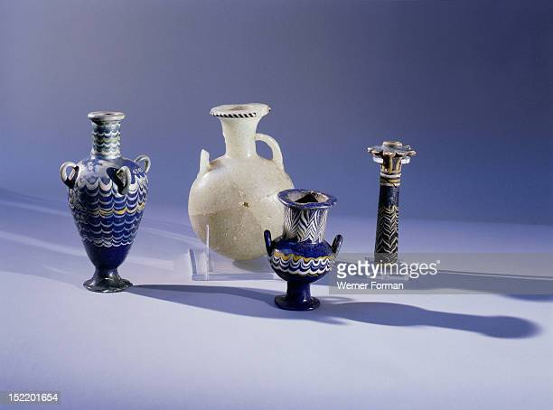 Cosmetic vessels Alabaster vessel with two perfume flasks and an eyepaint container The glass is decorated by impressing heated glass rods of various...
