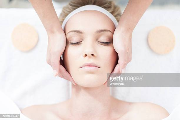 Cosmetician giving facial massage