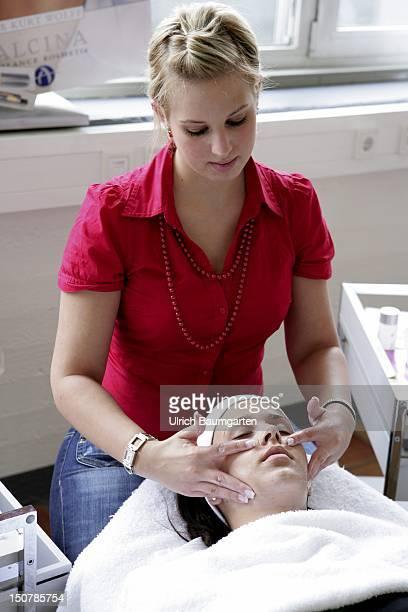 GERMANY COLOGNE A cosmetician who's being trained at the Bildungszentrum Butzweiler Hof der Handwerkskammer Koeln