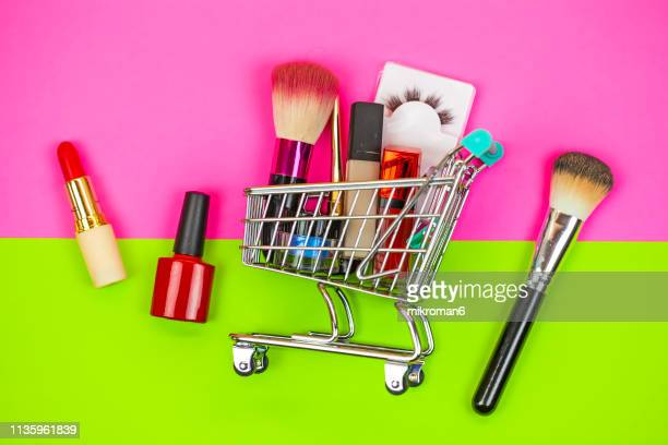 cosmetics and make up equipment in shopping cart - stage make up stock pictures, royalty-free photos & images