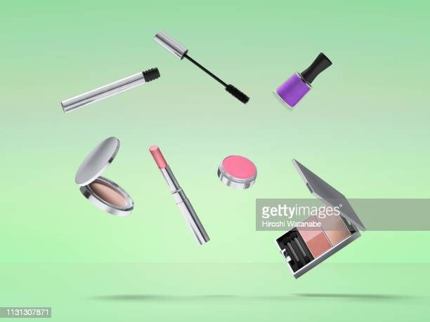cosmetics and sweets in the air. - make up stockfoto's en -beelden