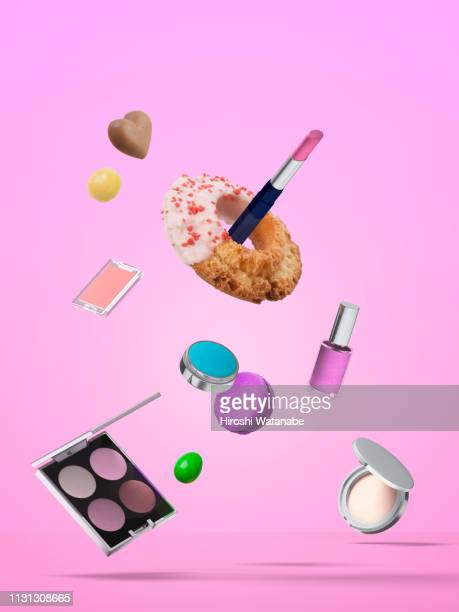 cosmetics and sweets in the air. - erotique chic photos et images de collection