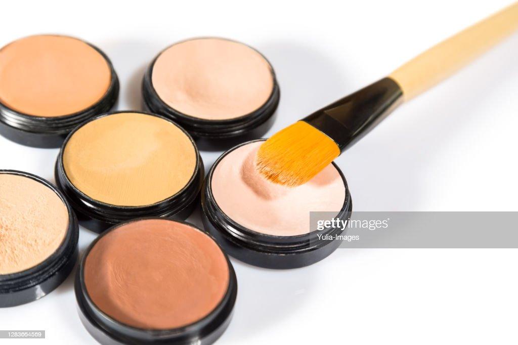 Cosmetics with brushes on white background : Stock Photo