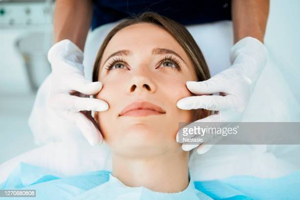 cosmetologist preparing for facial treatments - medical procedure stock pictures, royalty-free photos & images