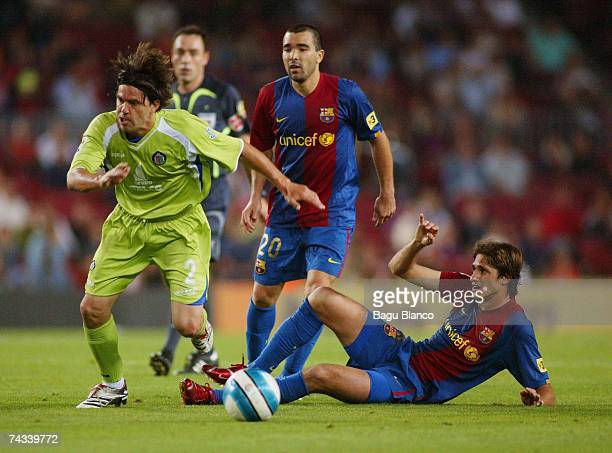 Cosmin Contra of Getafe and Edmilson and Deco of Barcelona and Albin of Getafe compere in action during the match between FC Barcelona and Getafe of...