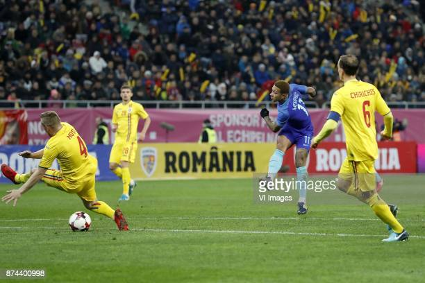 Cosmin Moti of Romania Florin Tanase of Romania Memphis Depay of Holland Vlad Chiriches of Romania during the friendly match between Romania and The...