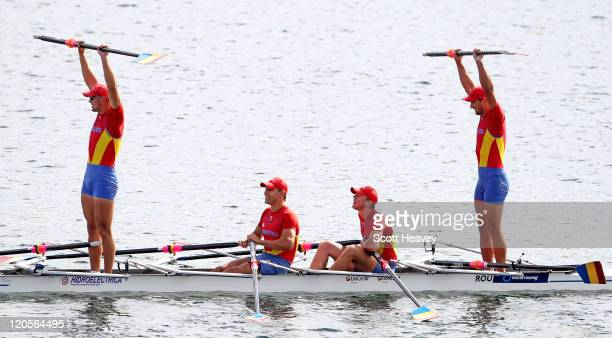 CosminIlie Cuciurean Adrian Cionca Ionut Luca and Ioan Prundeanu of Romania celebrate after winnning Gold in the Junior Men's Quadruple Sculls on Day...