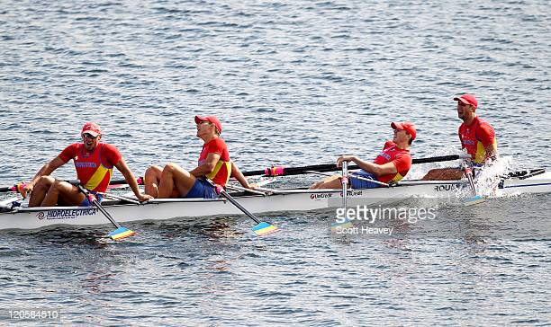 CosminIlie Cuciurean Adrian Cionca Ionut Luca and Ioan Prundeanu of Romania celebrate after winning Gold in the Junior Men's Quadruple Sculls on Day...