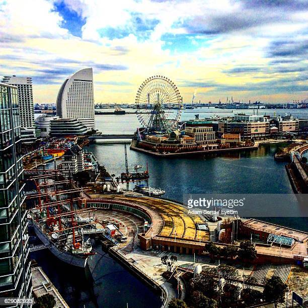 cosmo clock 21 in minato mirai against sky - adam rippon 2016 stock pictures, royalty-free photos & images