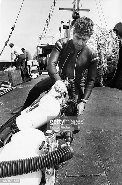 Cosmo Dies checks tanks prior to diving to the Andrea Doria 45 miles off the coast of Nantucket Mass on July 27 1968 He is part of a team of Italian...