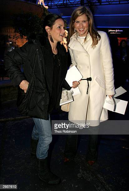 Cosmo Girl's Holly Cassin and Lisa Berger attend the Olympus Fashion Week in Bryant Park February 6 2004 New York City