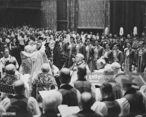 Cosmo Gordon Lang the Archbishop of Canterbury seen here placing the crown upon the head of King George VI during the Coronation ceremony at...