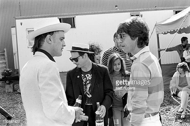Cosmo Vinyl Bernie Rhodes Jane Rose Jade Jagger and Mick Jagger backstage at The Clash show at JFK Stadium in Philadelphia Pennsylvania on September...