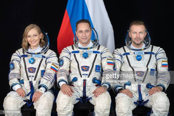 Cosmonaut Anton Shkaplerov , along with film director Klim Shipenko and actress Yulia Peresild poses for a photo ahead of the launch of the Soyuz...
