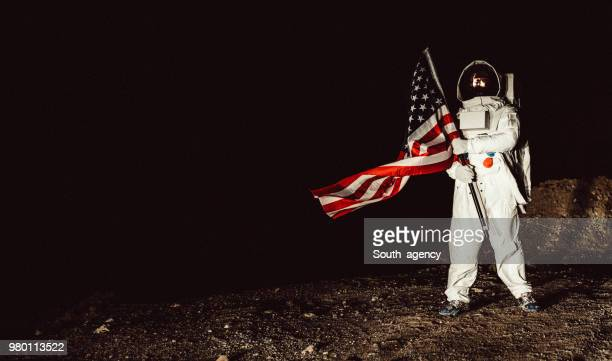 us cosmonaut conquering mars - moon surface stock pictures, royalty-free photos & images