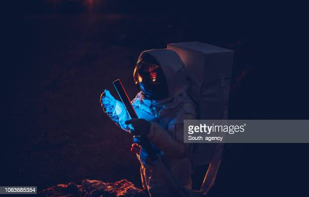 cosmonaut on dark mars - space exploration stock photos and pictures