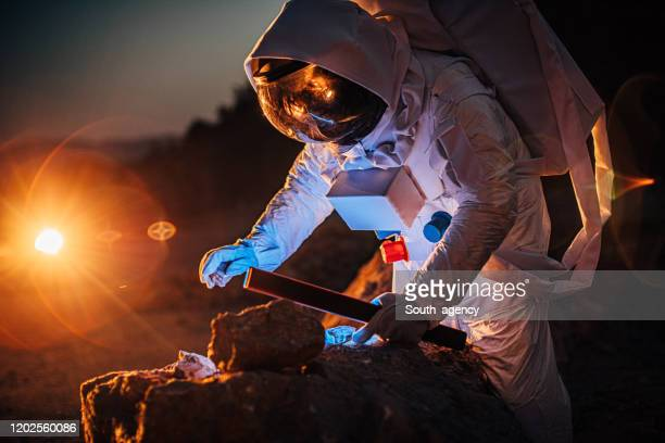 cosmonaut on mars - space suit stock pictures, royalty-free photos & images