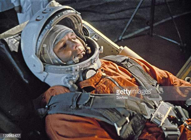 Cosmonaut yuri gagarin during last minute checks of vostok i control systems before launch 1961