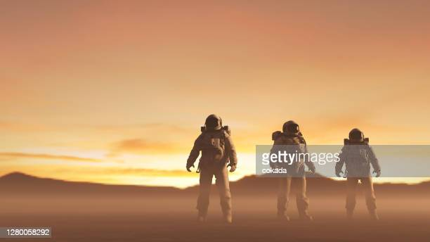 cosmonauts exploring remote planet - astronaut stock pictures, royalty-free photos & images