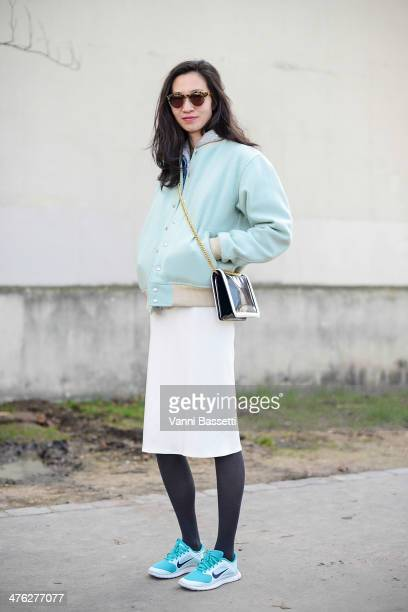 Cosmopolitan China's journalist Fei Teng wears American Apparel jacket Zara skirt Nike sneakers and Stella Mccartney bag before Celine show on March...