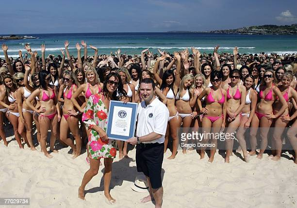 Cosmopolitan magazine editor Sarah Wilson and Guinness World Record Adjudicator Chris Sheedy pose during the world record attempt for the biggest...